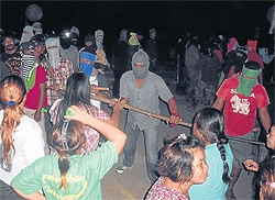 masked raiders: More than 300 men appeared in the village in the middle of the night to stop villagers from obstructing them from taking the copper ore. Many villagers were injured in the attack.