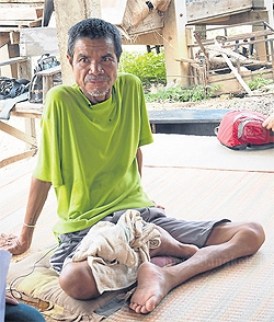 Cyanide: Former rice farmer Suwat Jutano claims exposure to contaminated water has left him paralysed from the waist down.